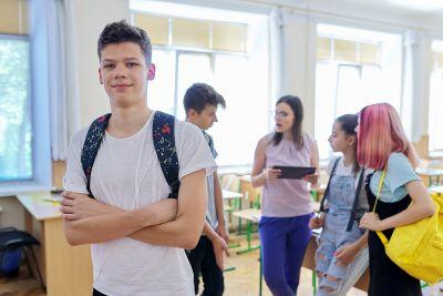 Portrait Of Teenage Boy Looking At Camera, Student Boy In Classr