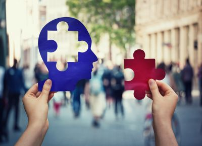 Two Hands Holding A Paper With Human Head And A Puzzle Piece. Fi
