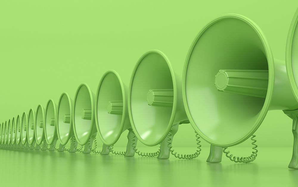 Many monochrome green megaphones stand in a row. Loudspeakers on a green background. Conceptual illustration with copy space. 3D rendering.