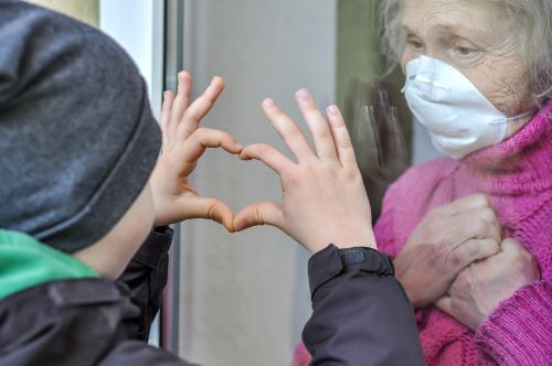 Grandmother Mature Woman In A Respiratory Mask Communicates With