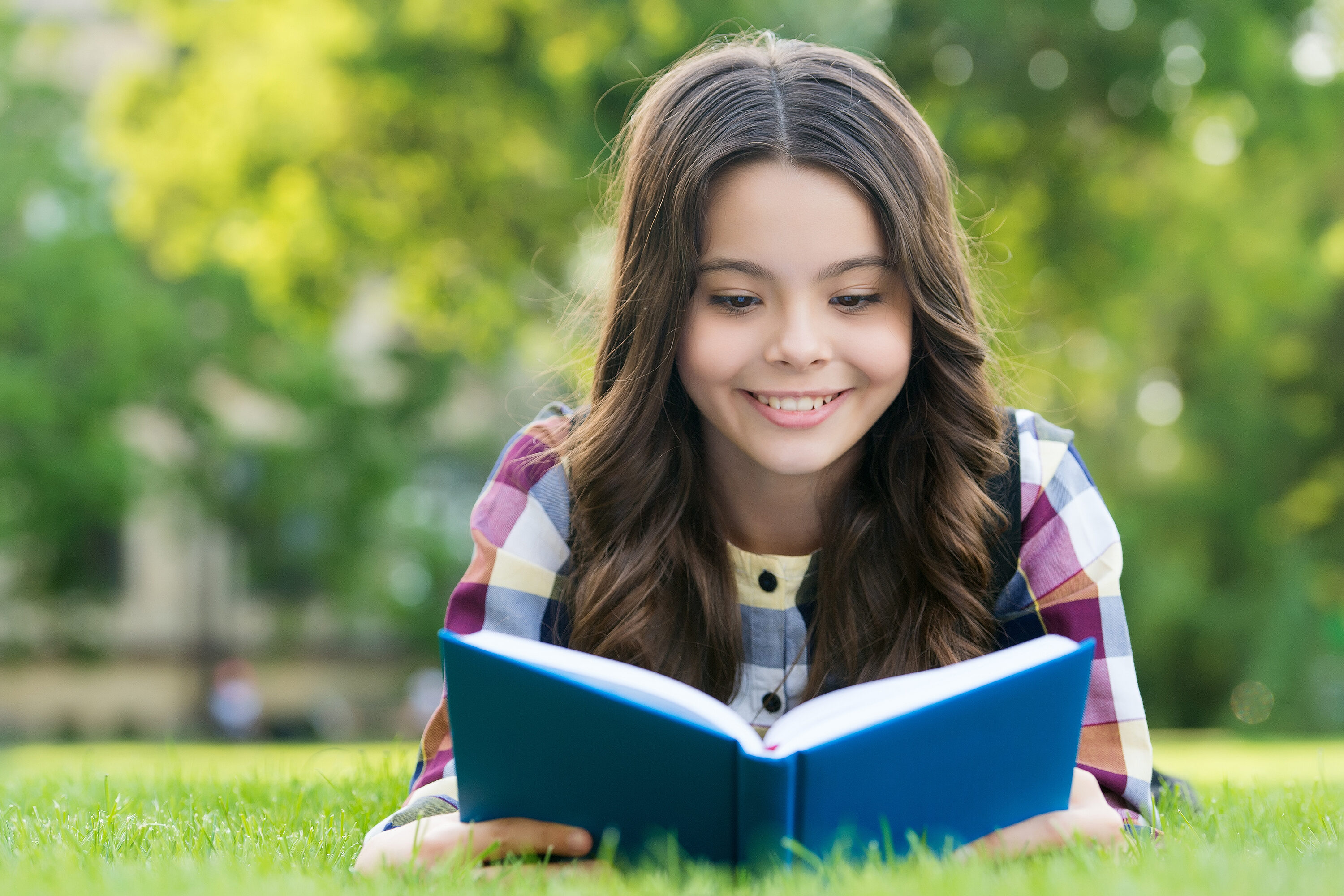Reading Only Enhances Your Knowledge. Happy Child Read Book Lyin